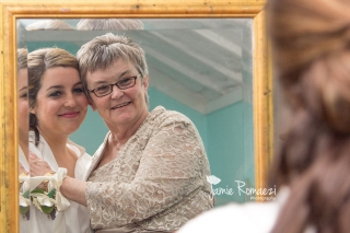 The bride and her momma have a sweet moment.