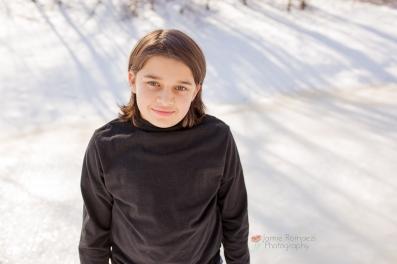 boy in snow jamie romaezi photography