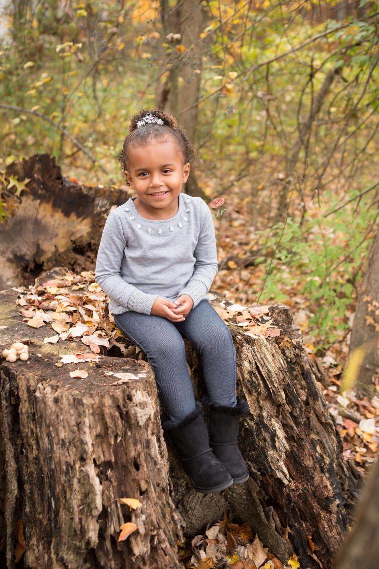 kid on tree stump jamie romaezi photography
