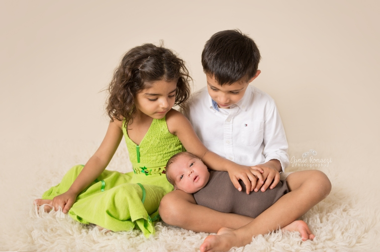 family of 3 newborn photos-sneak