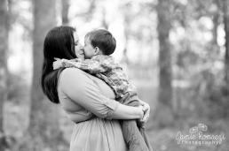 boy giving his mom a kiss in black and white