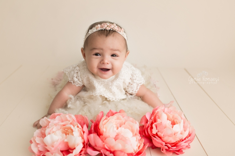 6 month milestone photos with flowers, pink and cream.