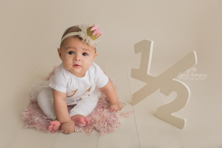 6 month old sitter session with pink and gold 1/2 birthday outfit, 1/2 birthday sign & crown.