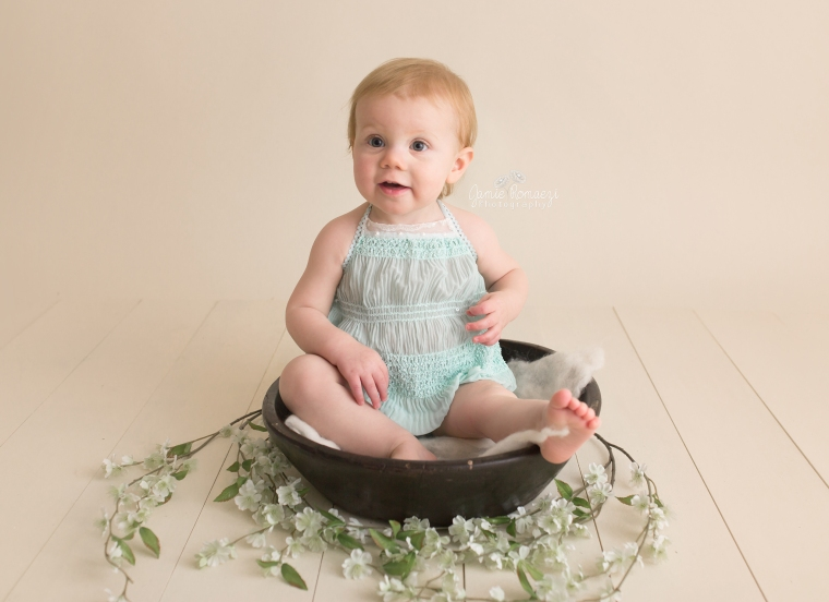 Baby sitting in a bowl.