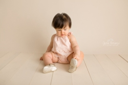 1 Year old playing with gold freshly picked moccasins.