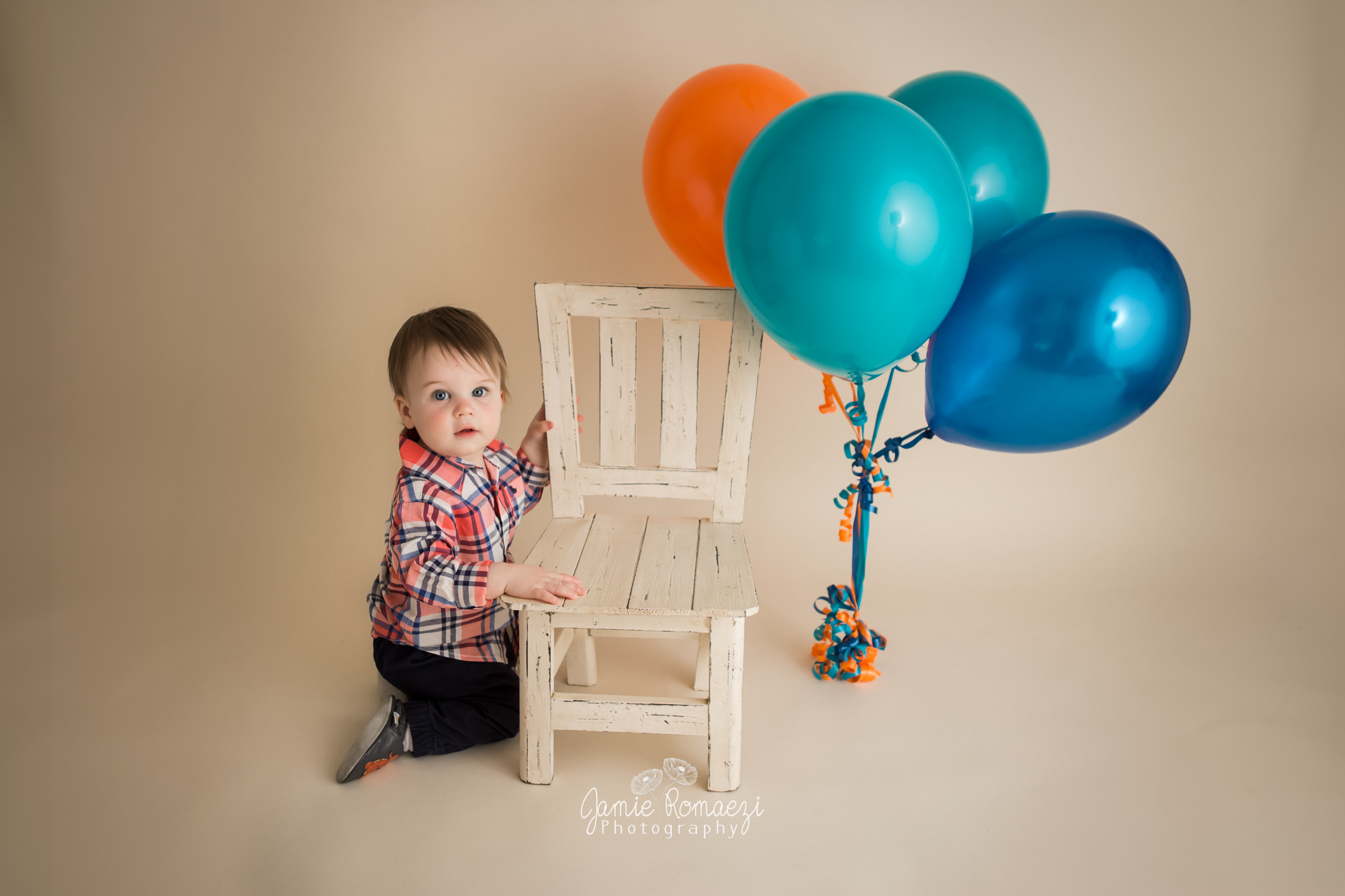 One year old with balloons
