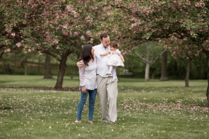 Family Spring Photos in front of Cherry Blossoms and daughter turns one