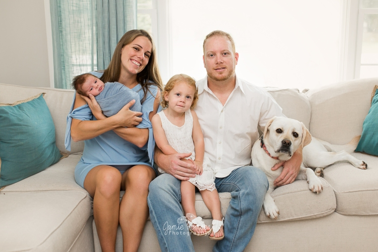 Newborn family portrait with yellow lab