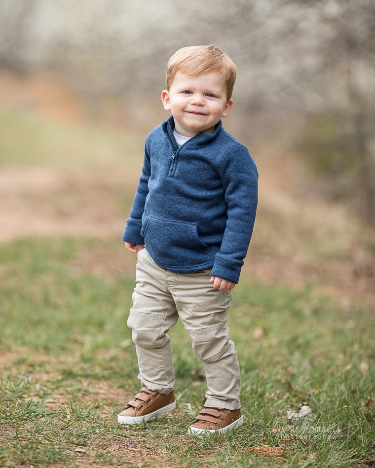 little boy wearing blue sweater and khaki pants